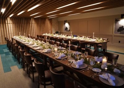 Private event room with two large rectangular feast tables.